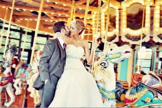 Seattle's Top Wedding Vendors   Bride and groom on carousel   Seattle's Best Hair and Makeup