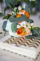 Seattle Tennis Club wedding in Seattle  Bridesmaid bouquet with orange and white flowers with succulents and greenery   Perfectly Posh Events, Seattle Wedding Planner   JTobiason Photography   Sublime Stems