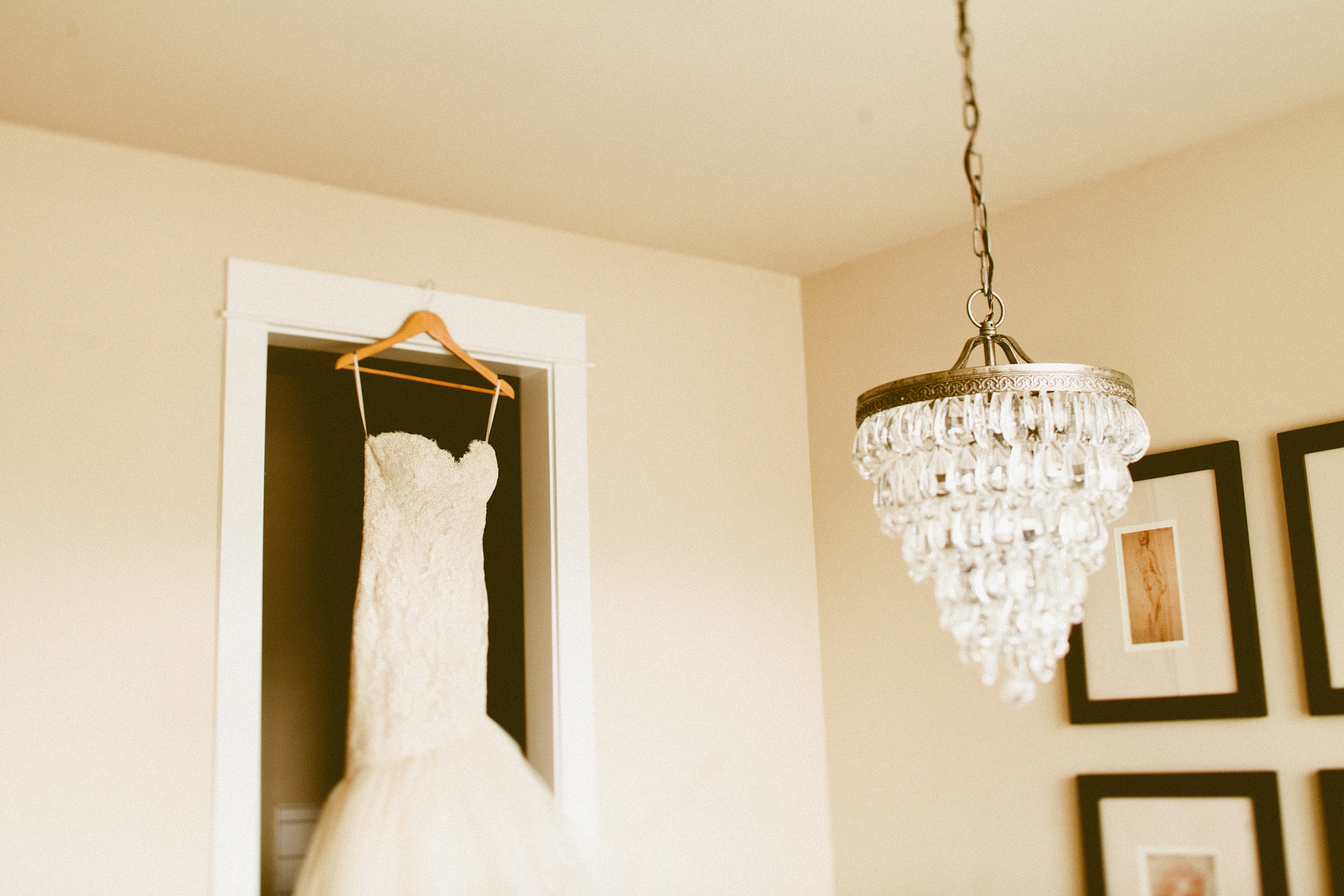 DeLille Cellars wedding in Woodinville |Lazaro gown hanging with chandelier | Perfectly Posh Events | Seattle Wedding Planner | Andria Lindquist Photography