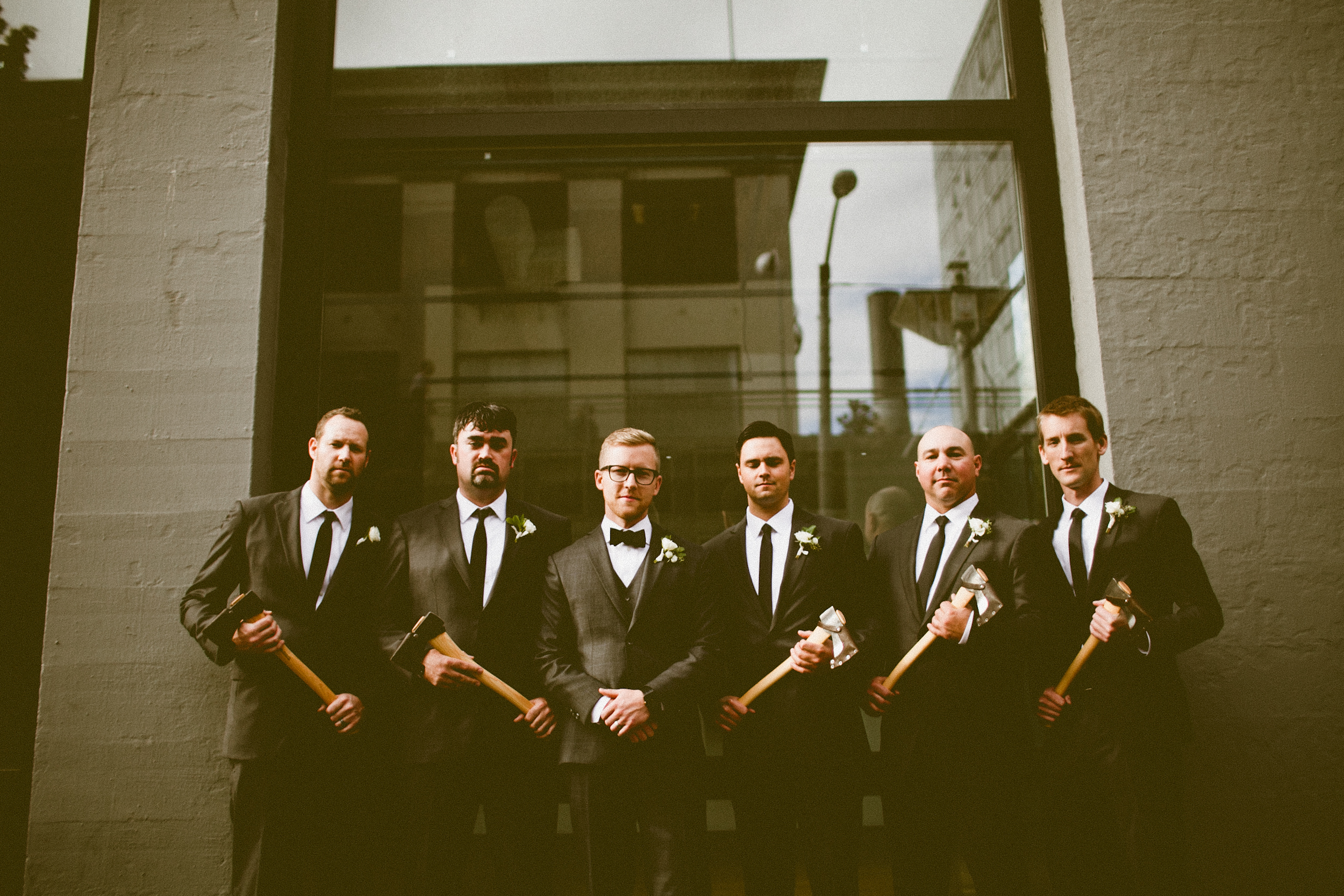 Sodo Park Wedding in Seattle | Groomsmen posing with groom and groomsmen gifts | Perfectly Posh Events, Seattle Wedding Planner | Andria Lindquist Photography