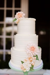 Robinswood House Wedding in Bellevue | Romantic three tiered white wedding cake with dahlias | Perfectly Posh Events, Seattle Wedding Planner | Courtney Bowlden Photography | Midori Bakery | Love Is Sweet wedding cake with pink sugar flowers