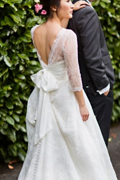 Robinswood House Wedding in Bellevue | Lace bridal gown with large back bow | Perfectly Posh Events, Seattle Wedding Planner | Courtney Bowlden Photography