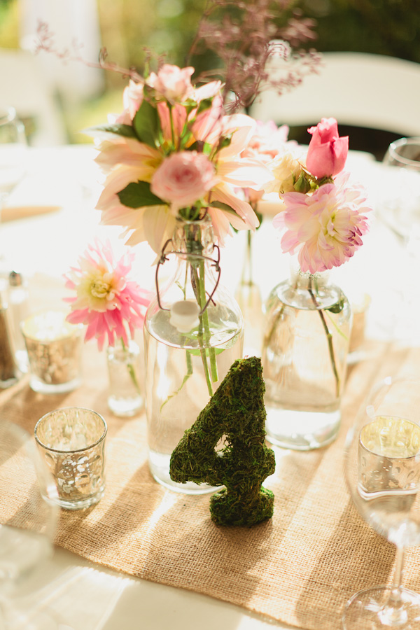 DeLille Cellars wedding in Woodinville | Moss wrapped table number with multiple smaller floral vases | Perfectly Posh Events | Lucid Captures Photography | Bella Signature Design