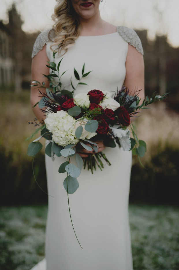 Cedarbrook Lodge wedding in Seattle | Wintery bridal bouquet with dark red roses, eucalyptus, ferns, and dusty miller | Perfectly Posh Events | Carly Bish Photography | Butter & Bloom