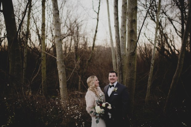 Cedarbrook Lodge wedding in Seattle |Winter, PNW wedding with dark, romantic colors. Bride in fur coat over wedding dress | Perfectly Posh Events | Carly Bish Photography | Butter & Bloom
