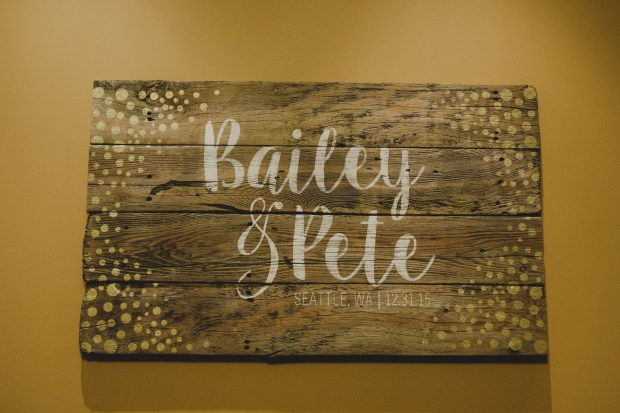 Cedarbrook Lodge wedding in Seattle | Rustic, hand-painted wooden wedding sign | Perfectly Posh Events | Carly Bish Photography