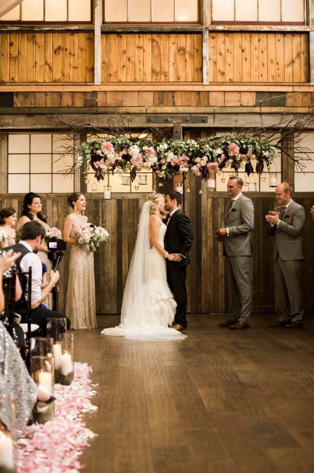 Sodo Park Wedding in Seattle | Elegant, romantic wedding ceremony in rustic venue with garden-themed hanging floral and branch altar piece | Perfectly Posh Events | Kimberly Kay Photography | Floressence