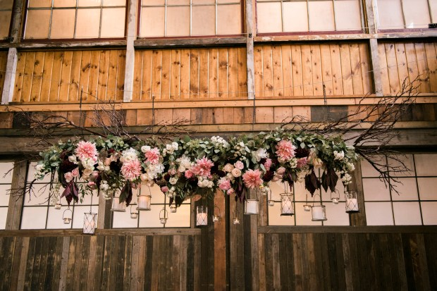 Sodo Park Wedding in Seattle |Romantic suspended floral and branch installation as altar piece with hanging candles | Perfectly Posh Events | Kimberly Kay Photography | Floressence