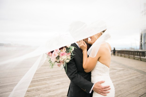 Sodo Park Wedding in Seattle | Romantic wedding photo of wind blowing veil around bride and groom | Perfectly Posh Events | Kimberly Kay Photography