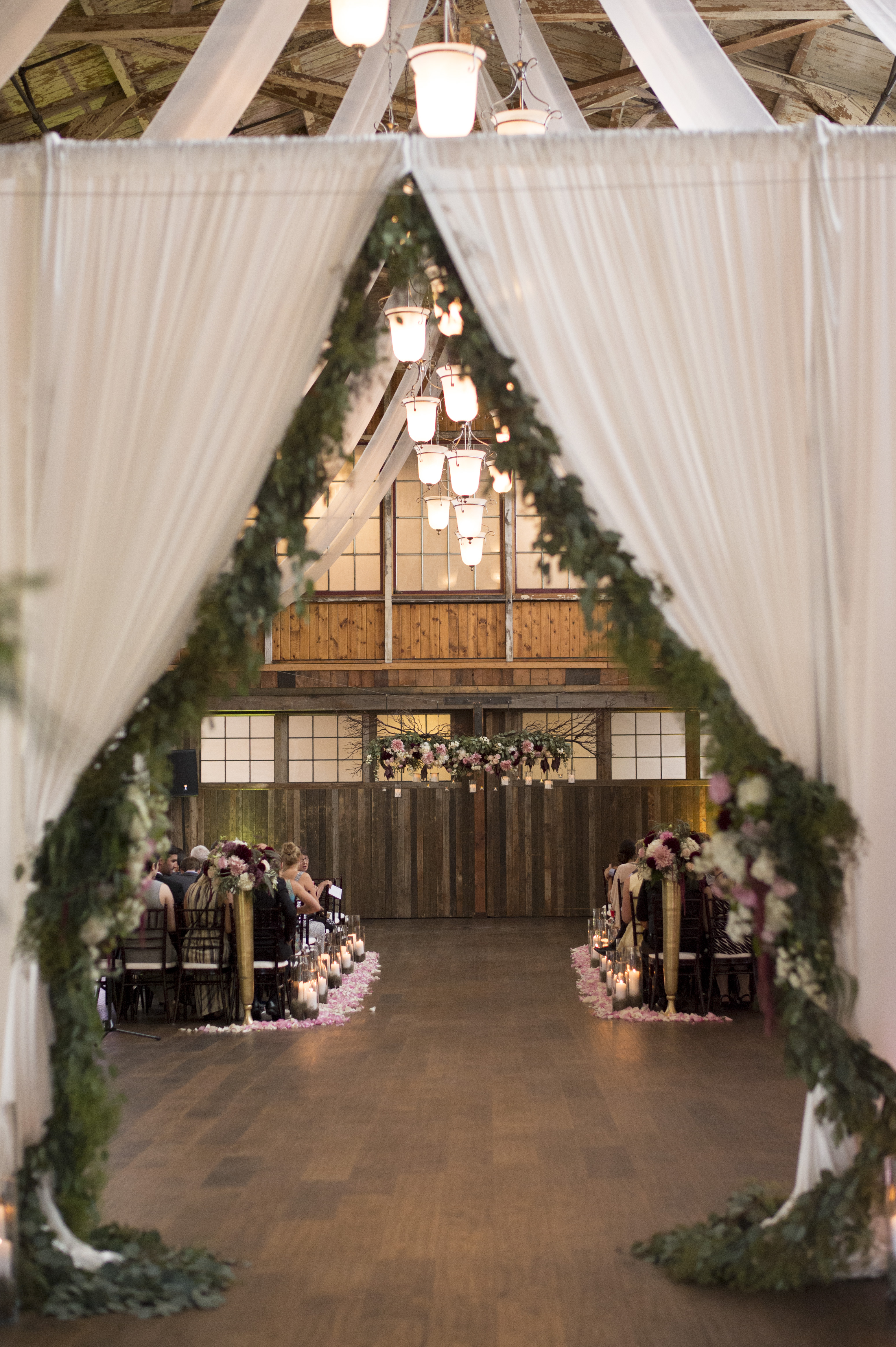 Sodo Park Wedding in Seattle | Elegant, garden ceremony decor, with greenery swag drapery, and hanging floral altar piece | Perfectly Posh Events | Kimberly Kay Photography | Floressence