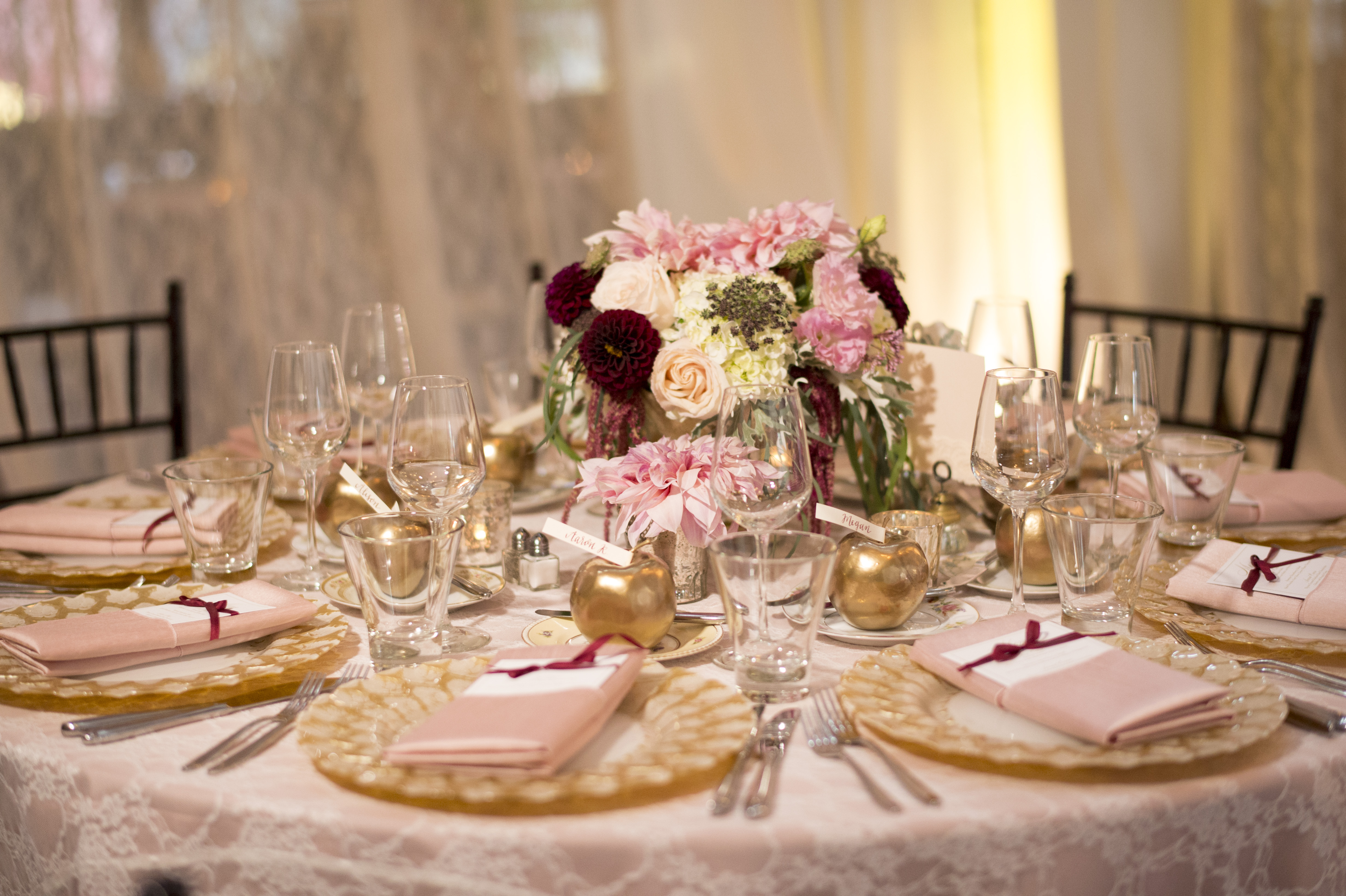 Sodo Park Wedding in Seattle | Elegant reception tables with gold chargers, lace and pink linens, and burgundy, pink, and cream floral centerpieces | Perfectly Posh Events | Kimberly Kay Photography | Floressence