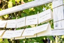 Hanging escort cards in wooden frame for wedding reception | Meadowbrook Farm Wedding, Snoqualmie, WA | Perfectly Posh Events, Seattle Wedding Planner | Sasha Reiko Photography | Jesse + Wes Wedding // © Sasha Reiko Photography