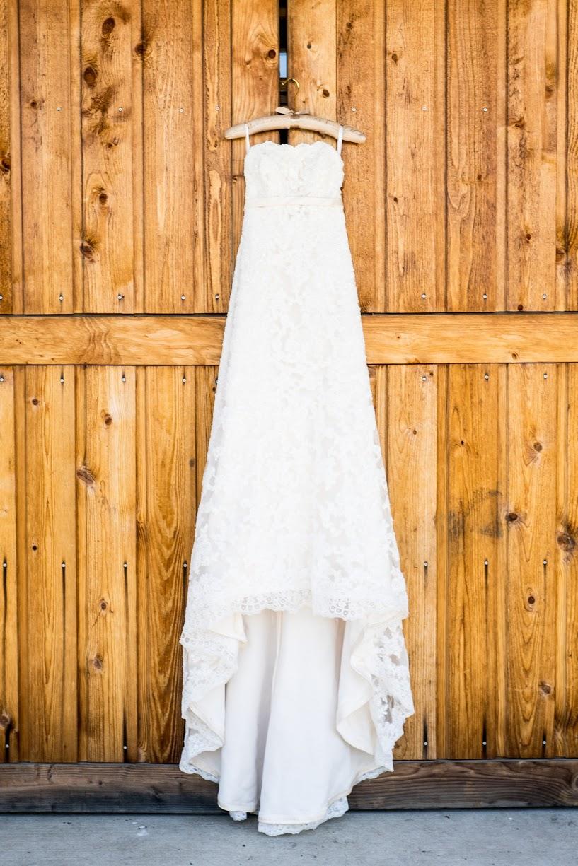 Ivory lace wedding gown hanging on barn door | Meadowbrook Farm Wedding, Snoqualmie, WA | Perfectly Posh Events, Seattle Wedding Planner | Sasha Reiko Photography | Jesse + Wes Wedding // © Sasha Reiko Photography