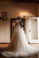 Bride on wedding day in tulle wedding dress at DeLille Cellars in Woodinville, WA
