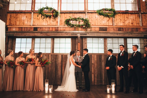 Sodo Park Wedding, Seattle WA   Wedding ceremony under trio of suspended greenery hoops   2017 Pantone Color of the Year, Greenery   Designed + Coordinated by Perfectly Posh Events   Paige Jones Photography   Floral Design by Butter & Bloom