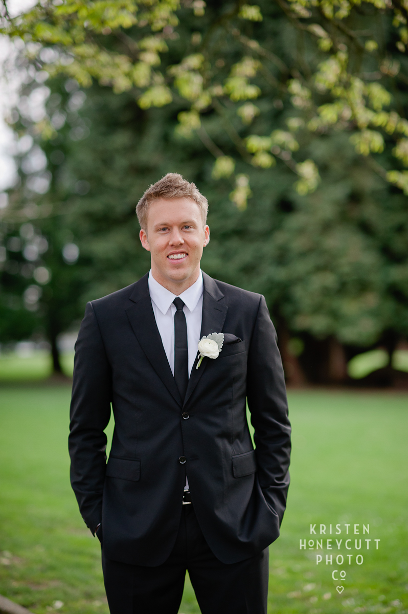 Melrose Market Studios Wedding in Seattle, WA | Groom wedding portrait poses with thin tie and classic boutonniere | Wedding Planning by Perfectly Posh Events, Seattle Wedding Planner | Kristen Honeycutt Photography | Floral Design by Contemporary Floral