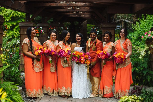Kiana Lodge Wedding on Bainbridge Island, WA | Stunning orange saris for bridesmaids in a vibrantly colored PNW wedding | Perfectly Posh Events, Seattle Wedding Planning | Shane Macomber Photography | Floral Design by Flora Nova
