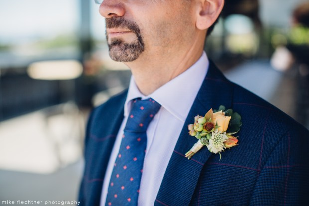 Hotel Ballard Wedding in Seattle | Groom in blue suit with orange spray rose boutonniere | Perfectly Posh Events, Seattle Wedding Planner | Mike Fiechtner Photography | Floral Design by The London Plane