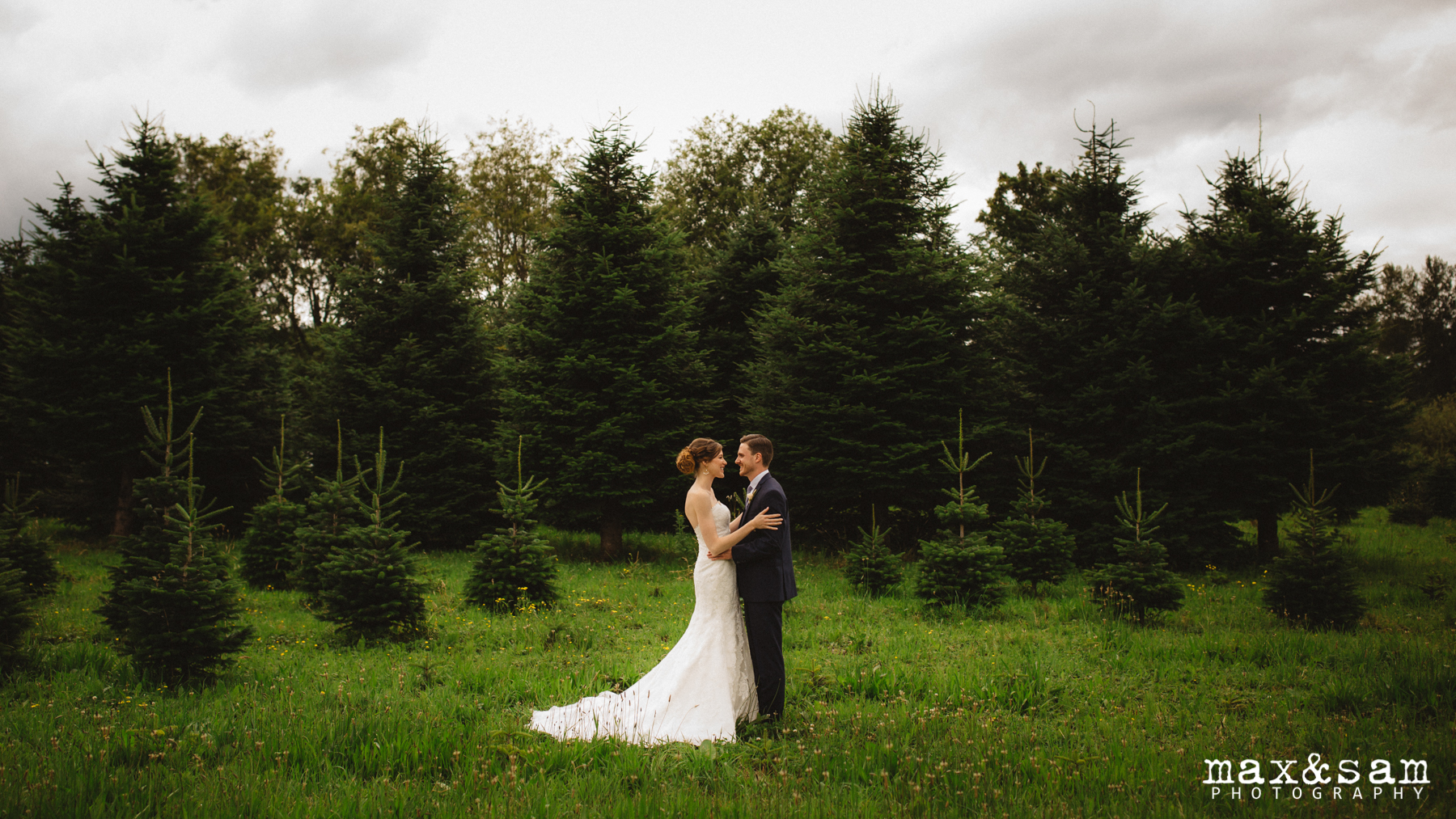 The Lodge at Fall City Wedding in Seattle, WA | PNW Portrait landscape with bride and groom standing in front of Christmas Tree Farm | Perfectly Posh Events, Seattle Wedding Planner | Max & Sam Photography