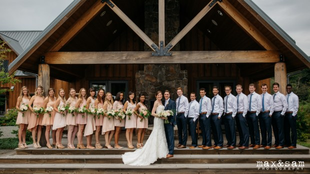 The Lodge at Fall City Wedding in Seattle, WA | PNW wedding party portrait in front of rustic lodge | Perfectly Posh Events, Seattle Wedding Planner | Floral Design by Sugar Pine | Max & Sam Photography