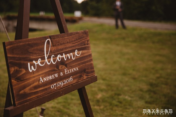 The Lodge at Fall City Wedding in Seattle, WA | Wooden welcome sign with modern calligraphy and serif fonts | Perfectly Posh Events, Seattle Wedding Planner | Max & Sam Photography