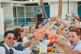 The Monkey Tree Hotel, Palm Springs wedding venue | group of wedding guests having drinks | Perfectly Posh Events, Seattle and Portland Wedding Planner