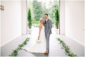 Bride and Groom on wedding day with wedding planner in Woodinville | Private Estate Wedding in Woodinville| Perfectly Posh Events: Seattle and Portland Wedding Planner | Photo by Blue Rose Photography