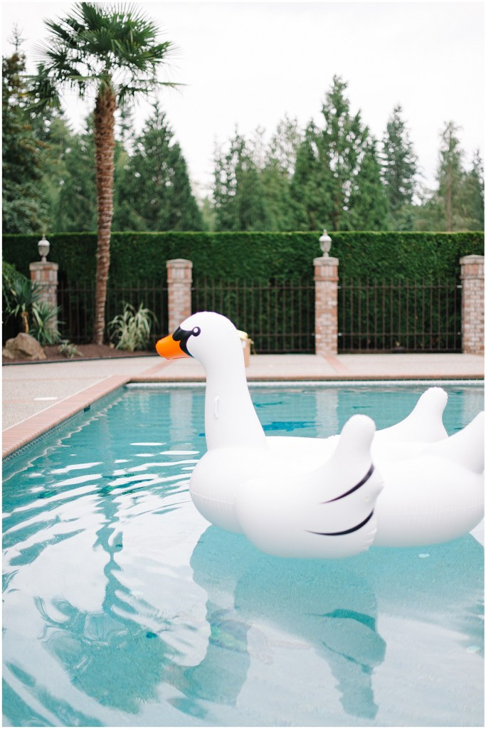 Wedding swan floating in the pool during the wedding cocktail hour, Private Estate Wedding in Woodinville, Wedding Planning and Design by Perfectly Posh Events: Seattle and Portland Wedding Planner, Photo by Blue Rose Photography