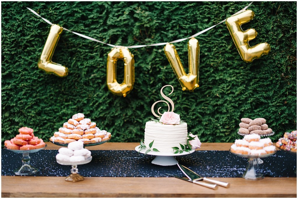 Doughnut and cutting cake wedding dessert display at Woodinville wedding | Private Estate Wedding in Woodinville| Perfectly Posh Events: Seattle and Portland Wedding Planner | Photo by Blue Rose Photography