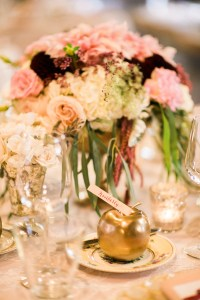 White, burgundy and blush floral table centerpiece with golden apple place card, Seattle wedding at Sodo Park, Perfectly Posh Events wedding planning and design, Seattle and Portland Wedding Planner, Photo by Kimberly Kay Photography