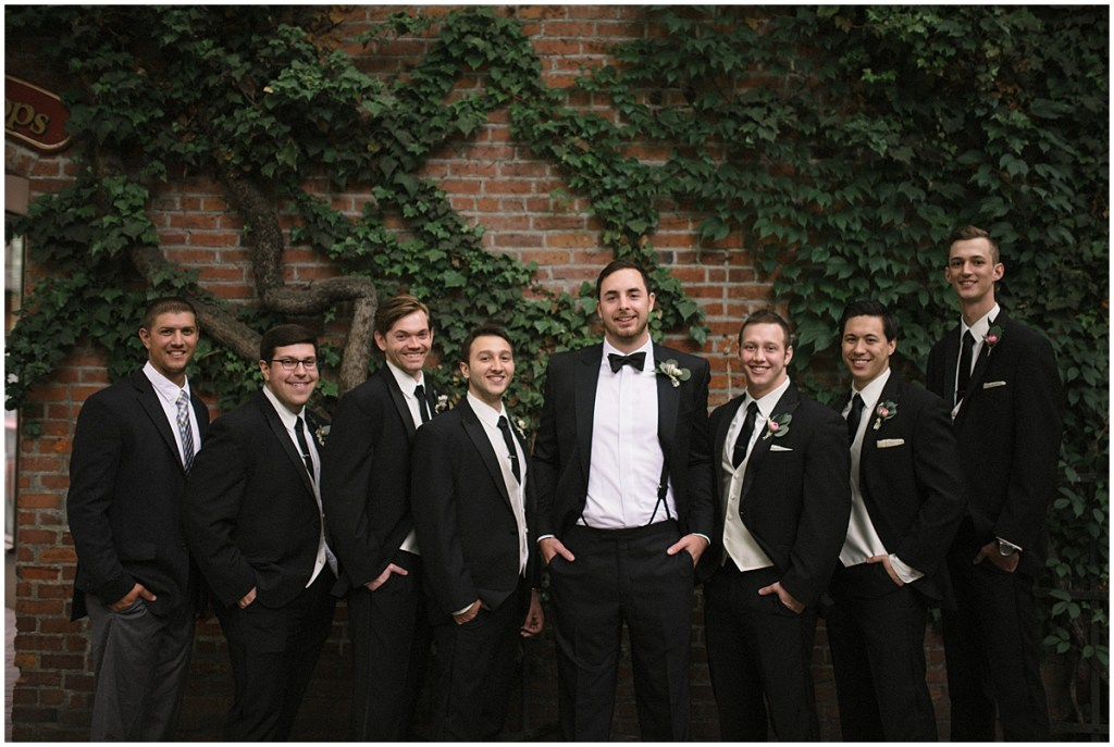 Grooms and groomsmen pose in tuxes in front of brick wall covered in vines, Axis Pioneer Square wedding, Seattle wedding, Perfectly Posh Events, Seattle Wedding Planner, Photo by Roland Hale