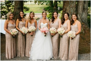 Bride in white tulle ballgown poses with bridesmaids in champagne colored gowns while holding a blush and ivory floral bouquets, Seattle wedding, Perfectly Posh Events wedding planning and design, Seattle and Portland Wedding Planner, Photo by Lucid Captures Photography