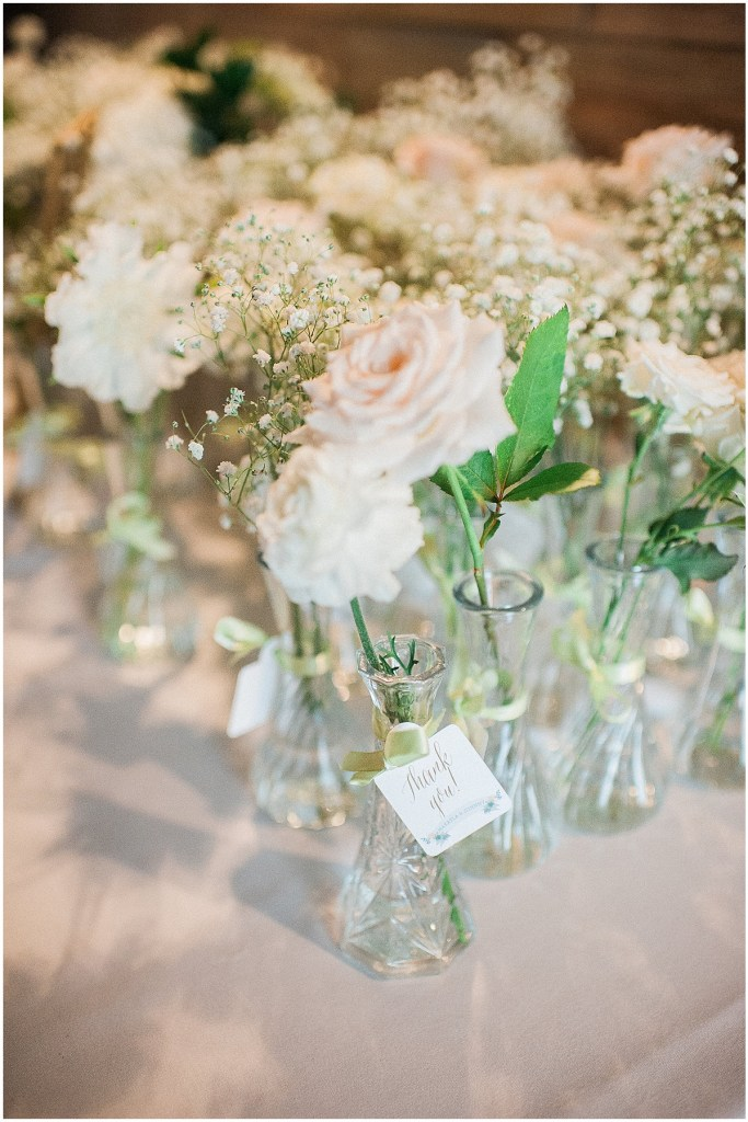 White roses and baby's breath in glass vases, Fremont Foundry wedding in Seattle, Wedding Planning and Design by Perfectly Posh Events, Seattle and Portland Wedding Planner, Photo by Alexandra Grace Photography, flowers by Studio 3 Floral Design