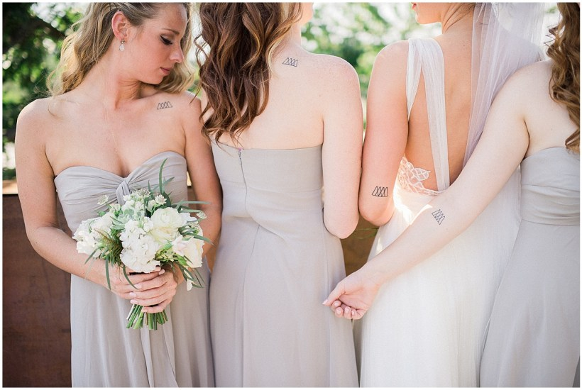 Bride with bridesmaids in light grey gowns, Fremont Foundry wedding in Seattle, Wedding Planning and Design by Perfectly Posh Events, Seattle and Portland Wedding Planner, Photo by Alexandra Grace Photography