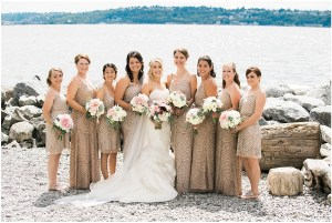 Bride posing with bridesmaids in champagne colored bridesmaid gowns, Seattle waterfront, Seattle wedding at Sodo Park, Perfectly Posh Events wedding planning and design, Seattle and Portland Wedding Planner, Photo by Kimberly Kay Photography