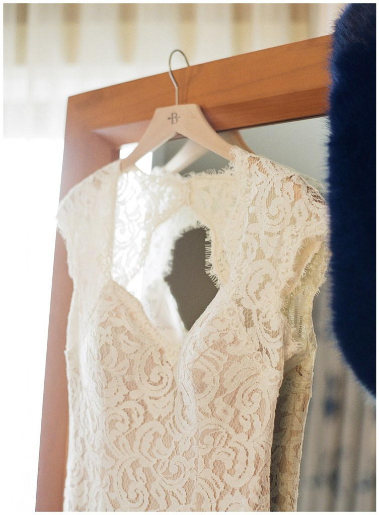 Metropolist Wedding in Seattle, WA | Same sex bride with white lace wedding gown and navy fur shawl | Seattle Wedding Planner, Perfectly Posh Events | Katie Parra Photography