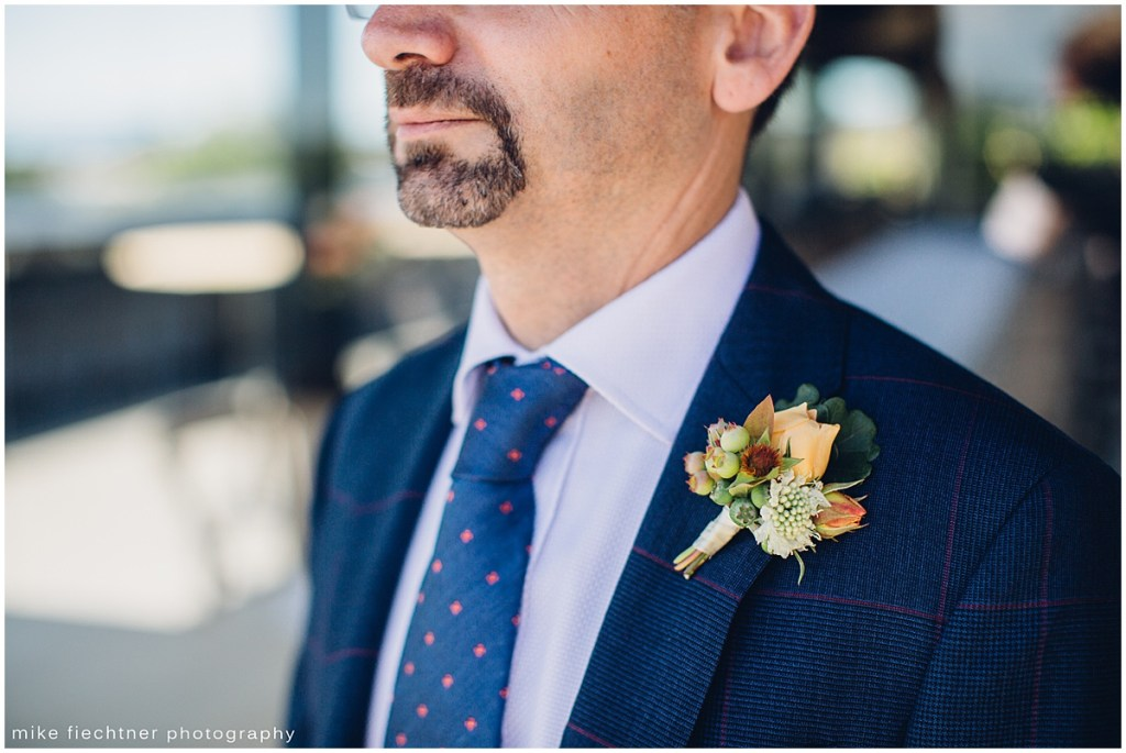 Groom in navy blue suit, Olympic Rooftop wedding, Seattle wedding, wedding planning by Perfectly Posh Events, Seattle and Portland Wedding Planner, Photo by Mike Fiechtner Photography