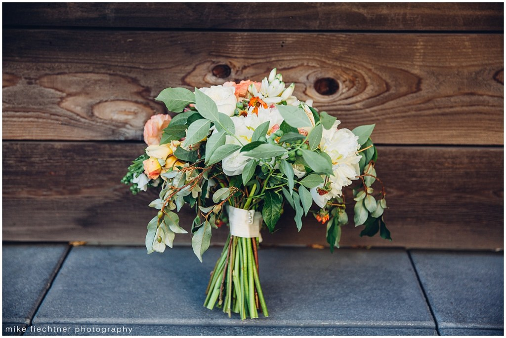 Bridal bouquet with white and coral flowers with touches of greenery, Olympic Rooftop wedding, Seattle wedding, wedding planning by Perfectly Posh Events, Seattle and Portland Wedding Planner, Photo by Mike Fiechtner Photography