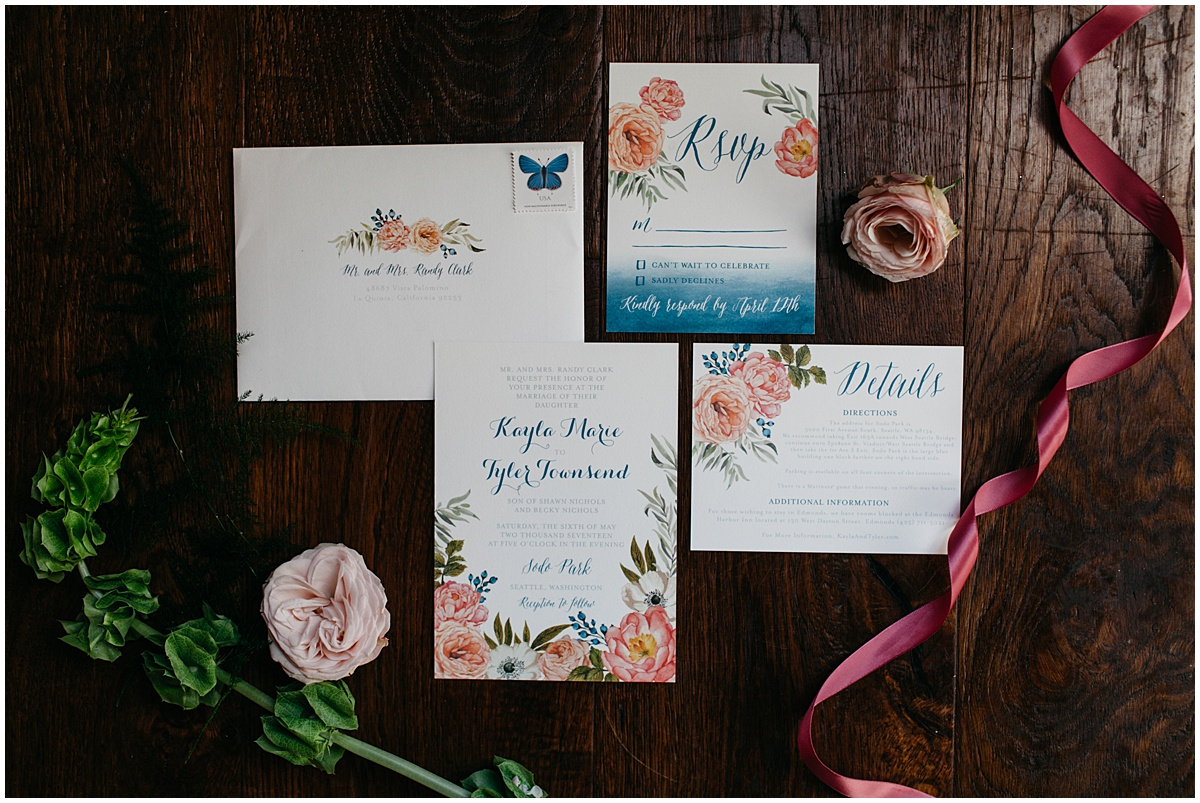 Custom wedding invitations with blue calligraphy and pink and coral flowers, Sodo Park wedding, Seattle wedding, Perfectly Posh Events wedding planning and design, Seattle and Portland Wedding Planner, Photo by Kate Price Photography