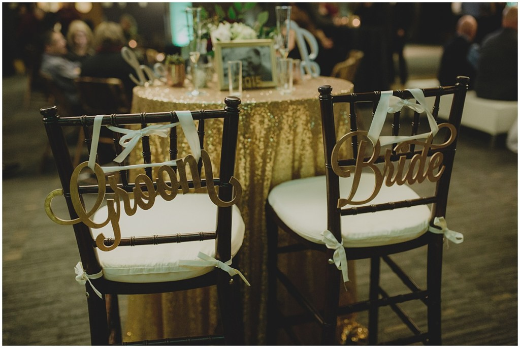 Bride and groom wedding table set up with gold sequin table cloth and gold signs on each chair, Cedarbrook Lodge wedding, Seattle wedding, Perfectly Posh Events wedding planning, Washington wedding planner, Photo by Carly Bish