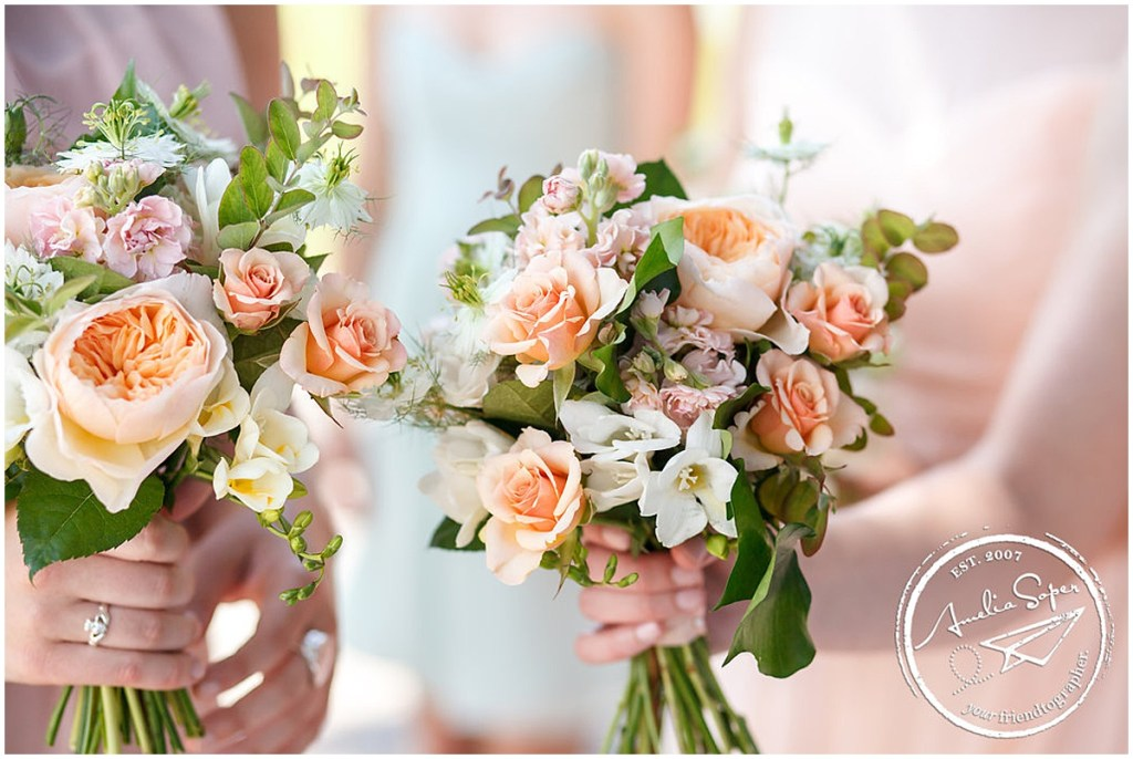Close up of two bridesmaids holding pink, coral, and ivory floral bouquets, Kiana Lodge wedding, Perfectly Posh Events wedding planning, Seattle wedding planning, Photo by Amy Soper Photography