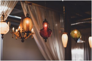 Multi colored vintage light pieces hand from ceiling, Mid Century modern wedding,The Foundry by Herban Feast wedding, Seattle wedding, Perfectly Posh Events wedding planning and coordination, Photo by Carina Skrobecki