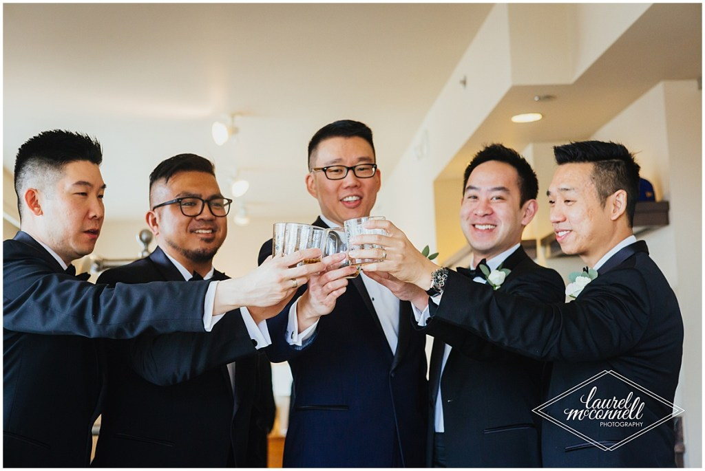 A groom toasts with drinks in high ball glasses with his groomsmen, The Foundry by Herban Feast wedding, Seattle wedding, wedding planning by Perfectly Posh Events, Photo by Laurel McConnell Photography