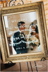 Wedding welcome sign hand painted onto a mirror in a gold vintage frame, The Foundry by Herban Feast wedding, Seattle wedding, wedding planning by Perfectly Posh Events, Photo by Laurel McConnell Photography