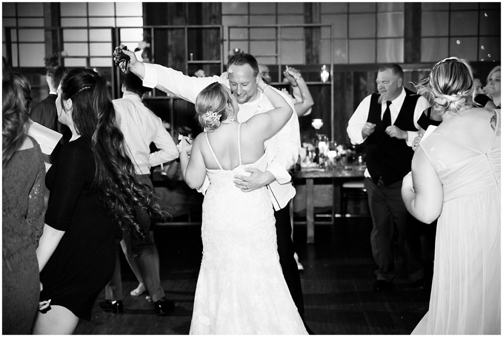 Black and white photo of bride and groom sharing a dance at their wedding reception, Sodo Park wedding, Seattle wedding planner, Perfectly Posh Events, Photo by La Vie Photography