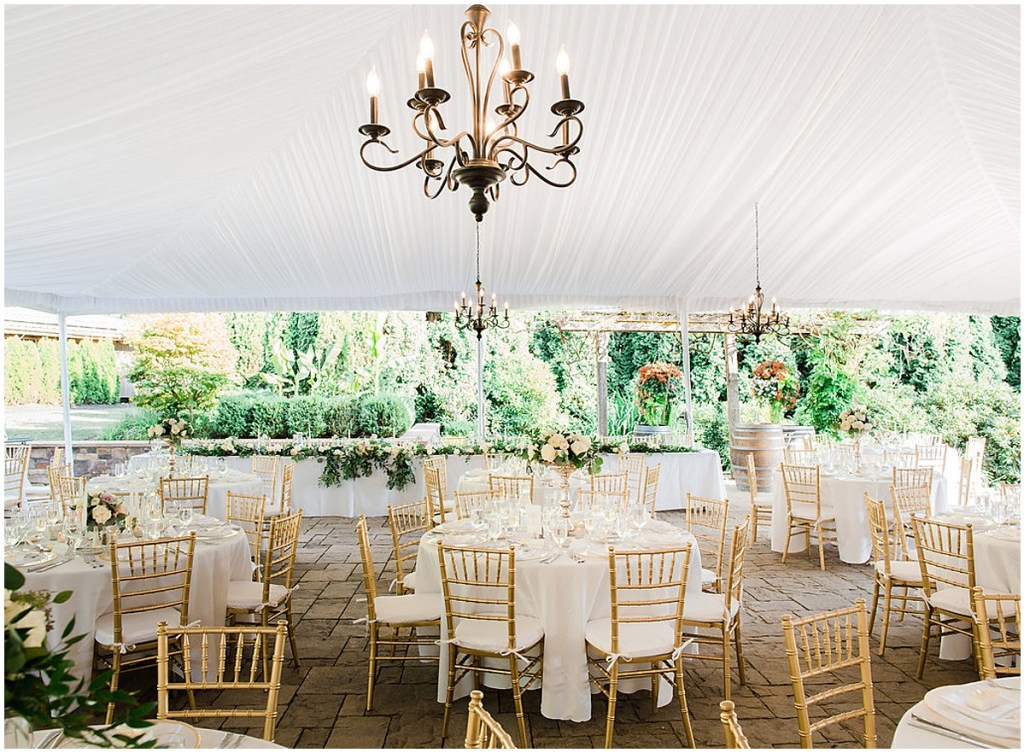 Outdoor wedding reception under a white tent set up with tables white table linens and anchored with gold painted chairs, DeLille Cellars wedding, Woodinville wedding, Perfectly Posh Events wedding coordination, Photo by Great Romance Photography