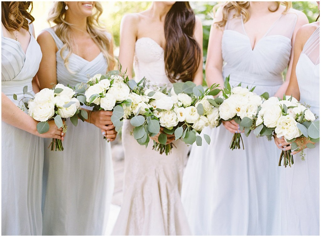 Bride poses with bridesmaids in mint colored gown while holding while holding ivory floral bouquets with greenery, DeLille Cellars wedding, Woodinville wedding, Perfectly Posh Events wedding coordination, Photo by Great Romance Photography