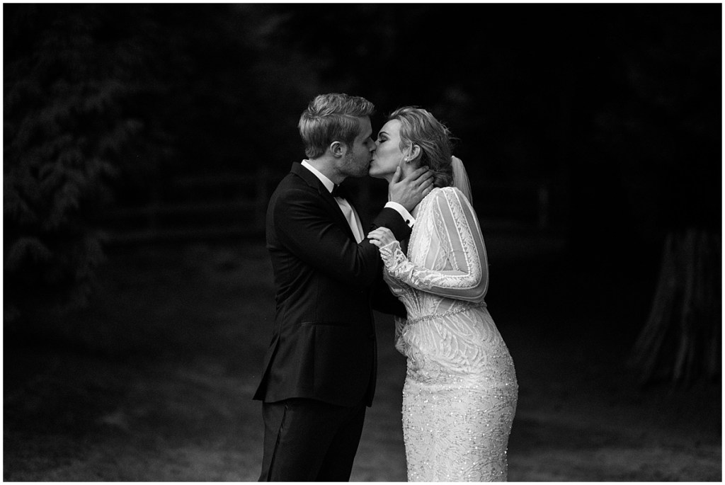 Black and white photo of bride and groom sharing a kiss outdoors, DeLille Cellars wedding, Washington wedding planner, Perfectly Posh Events, Photo by Shane Macomber Photography