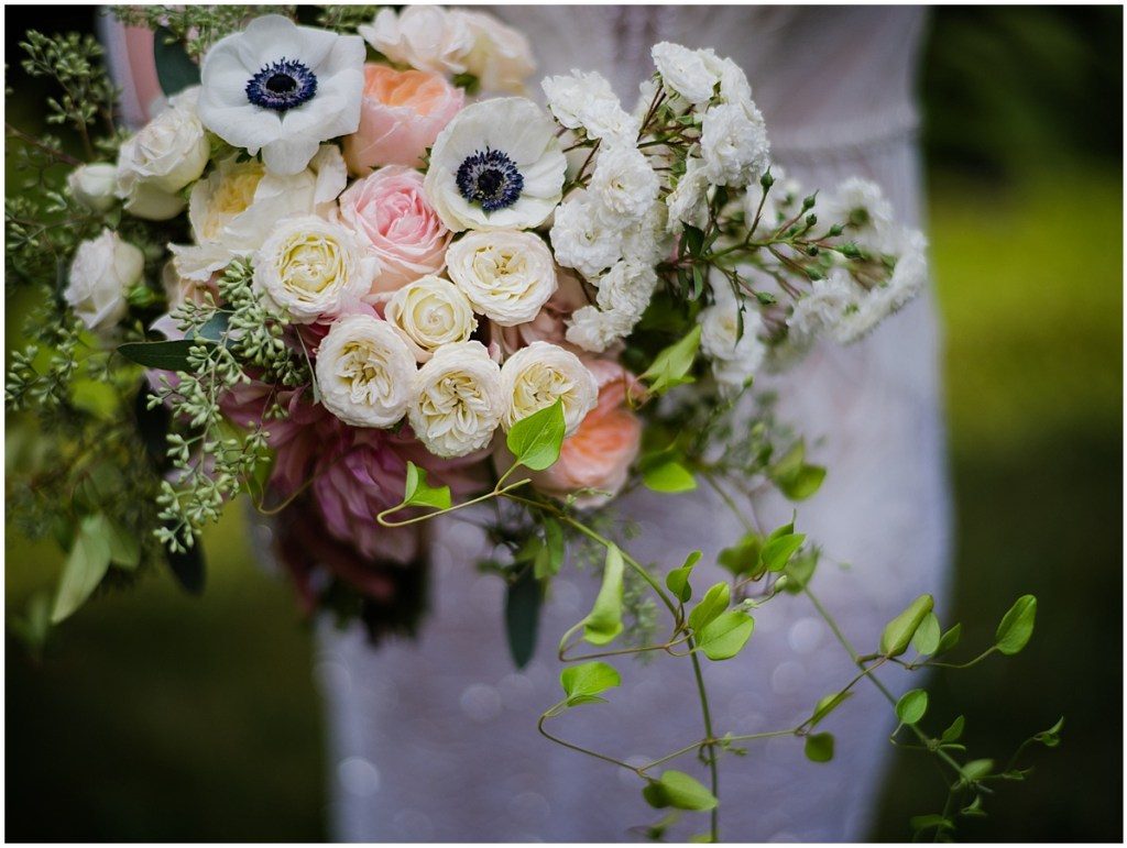 Close up of bridal bouquet made of ivory and blush colored flowers with touches of greenery, DeLille Cellars wedding, Washington wedding planner, Perfectly Posh Events, Photo by Shane Macomber Photography