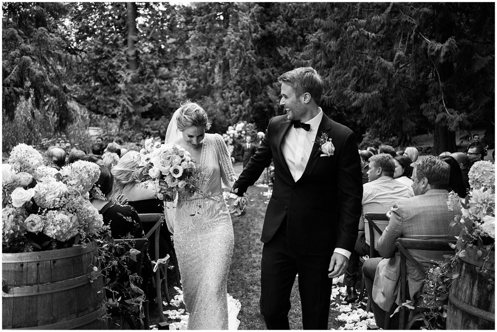 Black and white photo of newlywed bride and groom walking back down the aisle after exchanging vows, DeLille Cellars wedding, Washington wedding planner, Perfectly Posh Events, Photo by Shane Macomber Photography